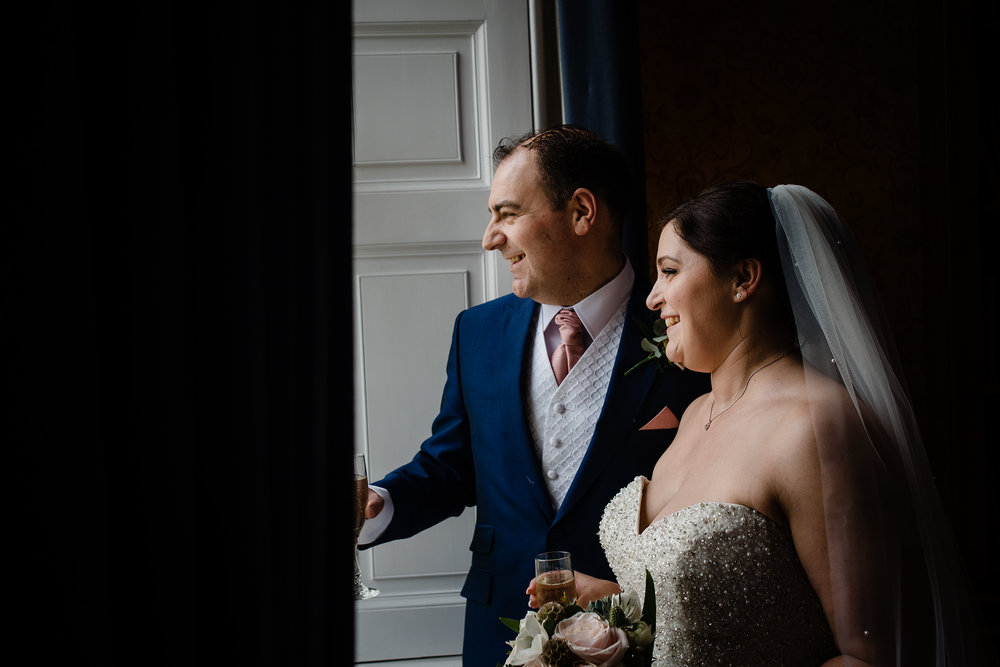 Bride and Groom window portrait at botleys mansion