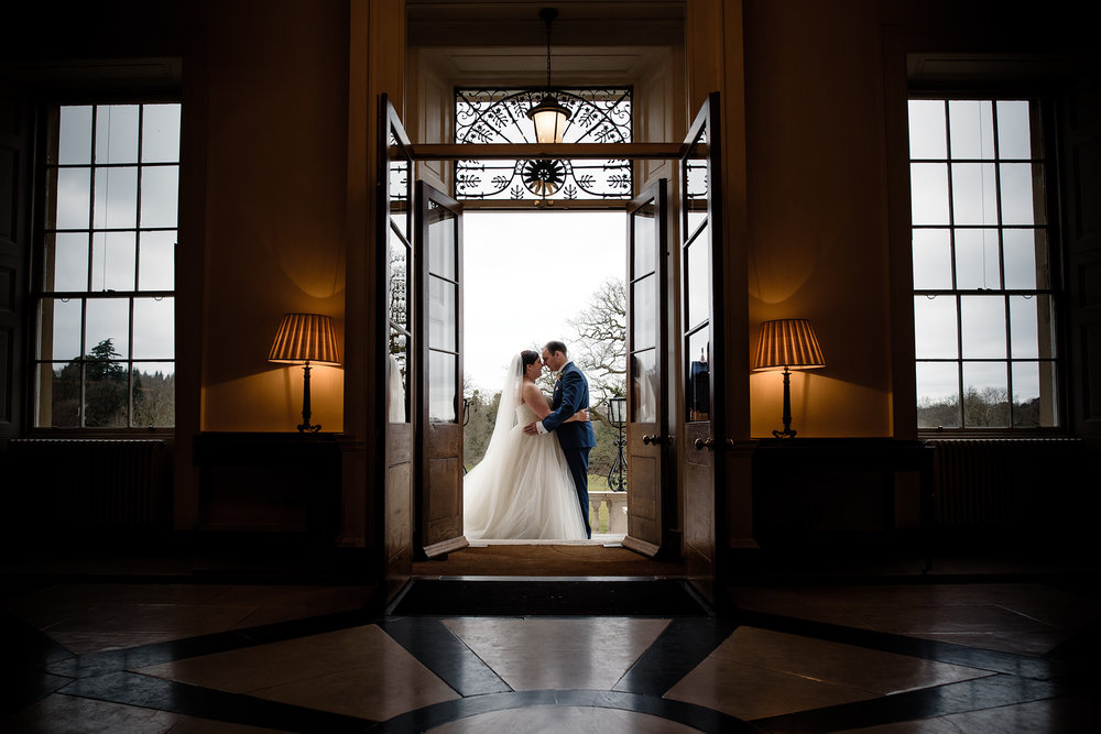 Bride and groom doorway portrait at botleys mansion