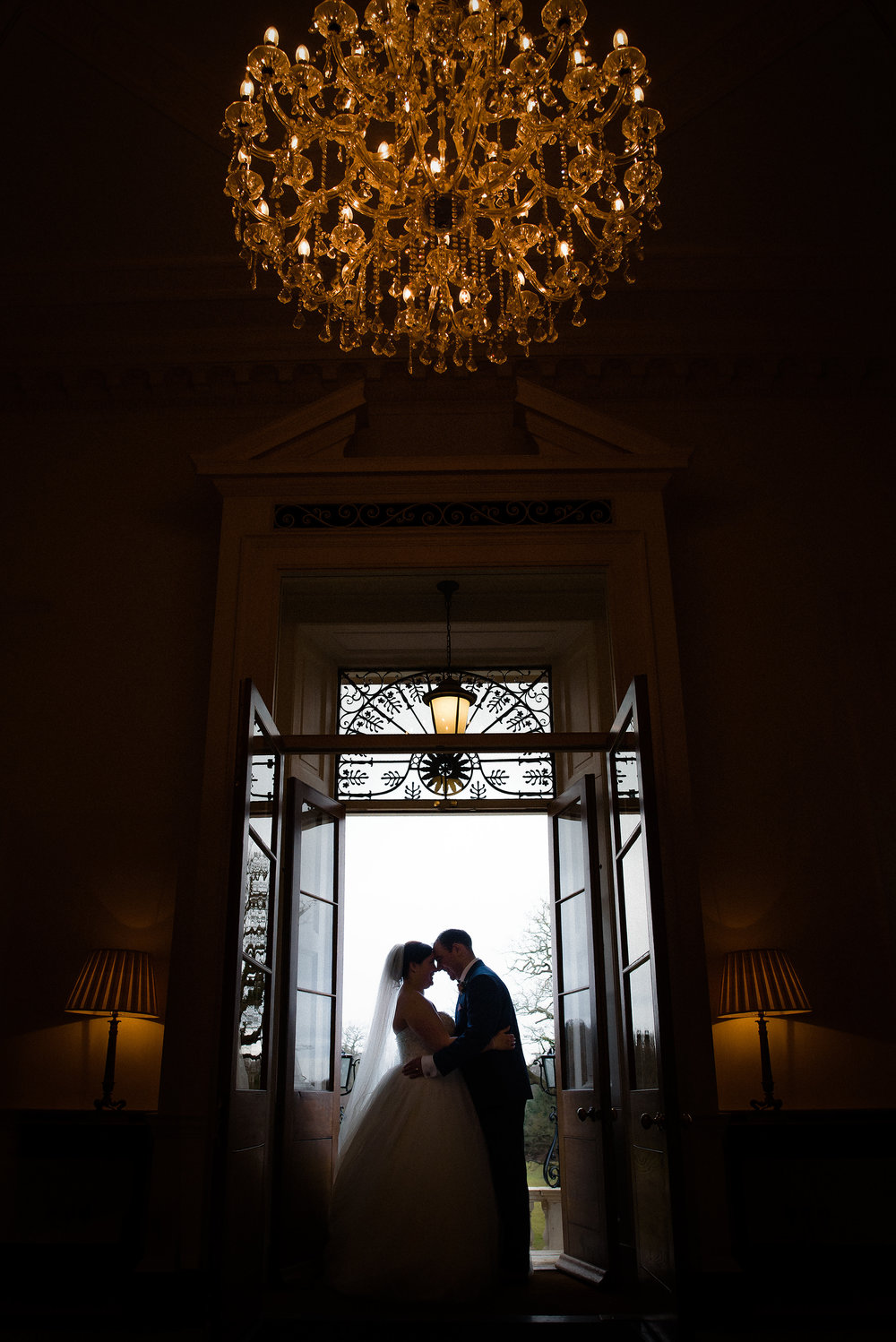 Bride and groom silhouette at botleys mansion