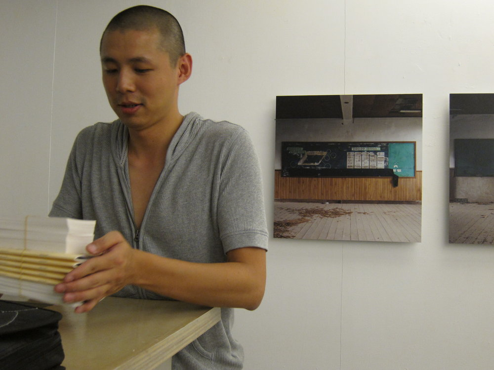 Artist Wu Shang Lin in front of his work- Space of Remembrance, 12 mins, Video still, 2008.