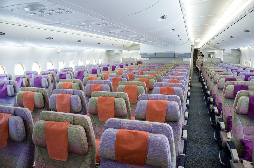 The colourful Economy Class cabin