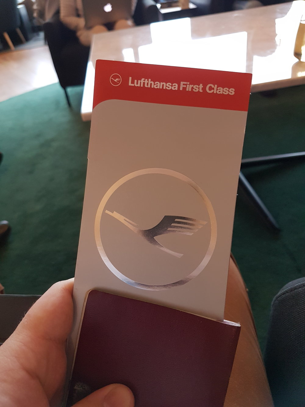 The boarding pass holder makes it easy for the Lufthansa staff to see that I am traveling First!