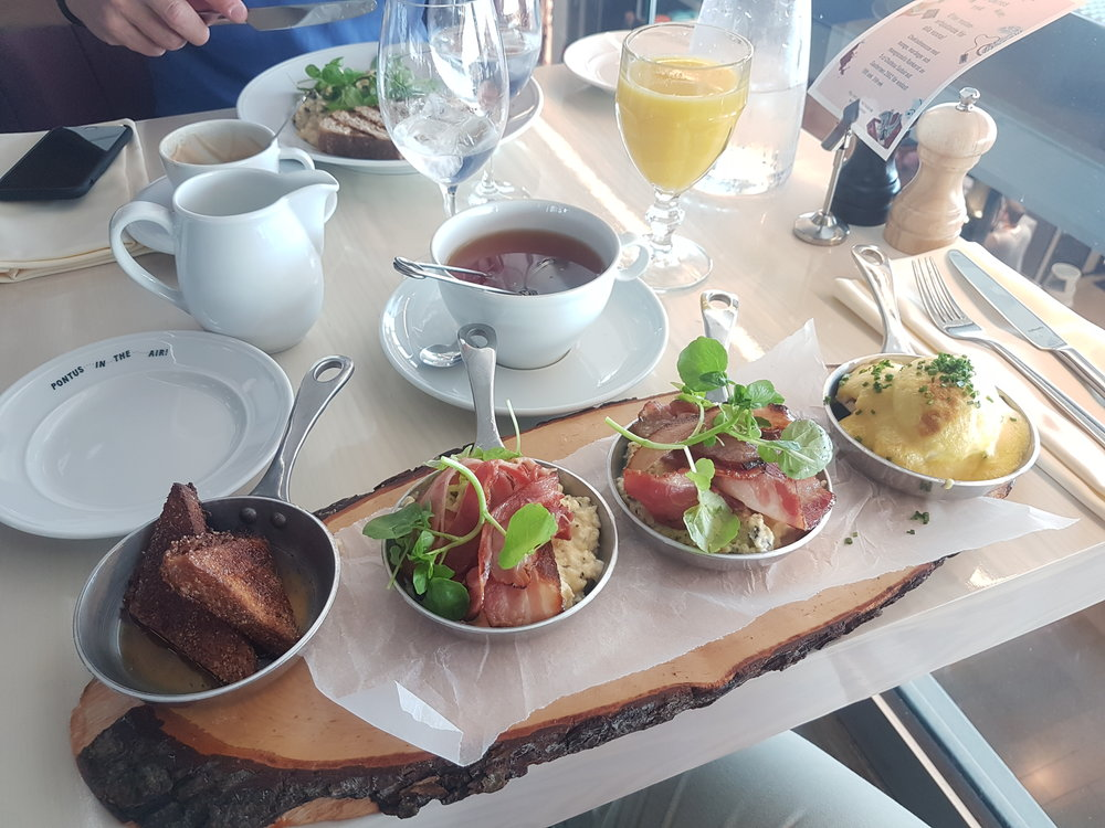 Captains Choice - French Toast, Two bowls of truffle scramble eggs with bacon and a Egg benedict with lobster