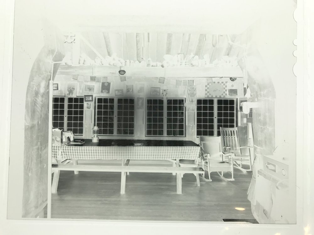 A negative of the dining room at Cloud Cap Inn as seen on a light table.