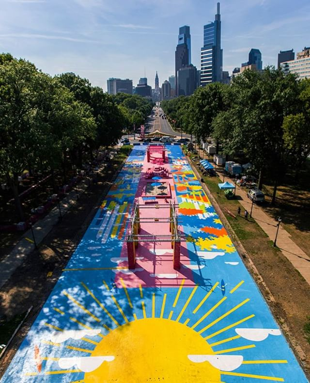 Each summer @TheOvalPHL – a 22,000 square foot public space in the heart of Philadelphia – gets a new paint job. This year's was designed by @theheadsofstate and installed by @muralarts. - Photo: @emilybucholz