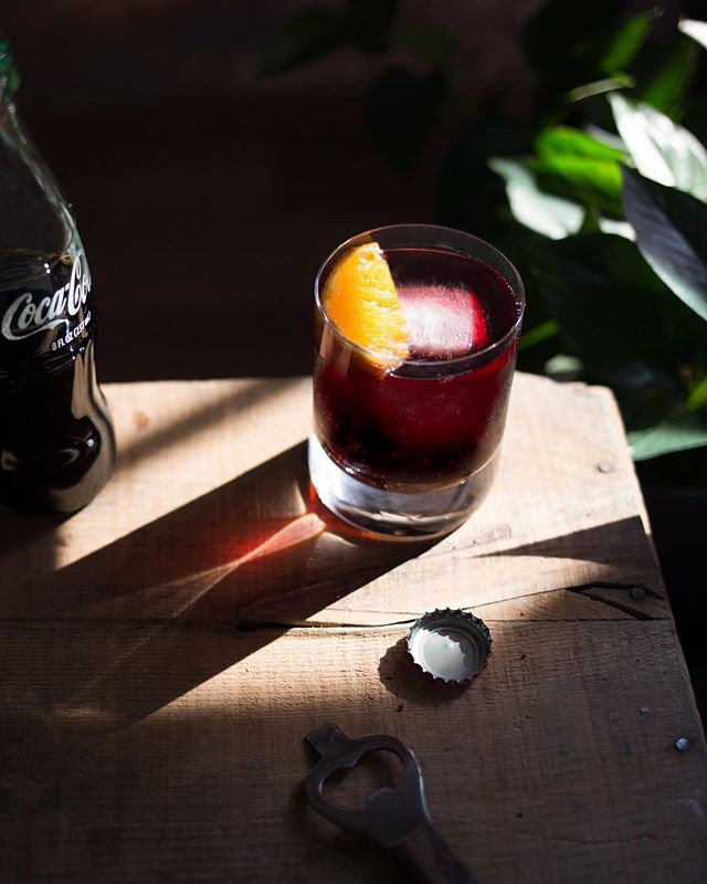 The Kalimotxo - 1 part dry red wine, 1 part Mexican Coca-Cola, pour over ice, add a squeezed orange slice.