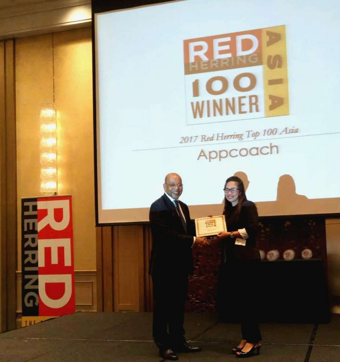 April Tayson, APAC Head of Sales at Appcoach accepts the Asia Top 100 Winner Award at the Red Herring Forum 2017