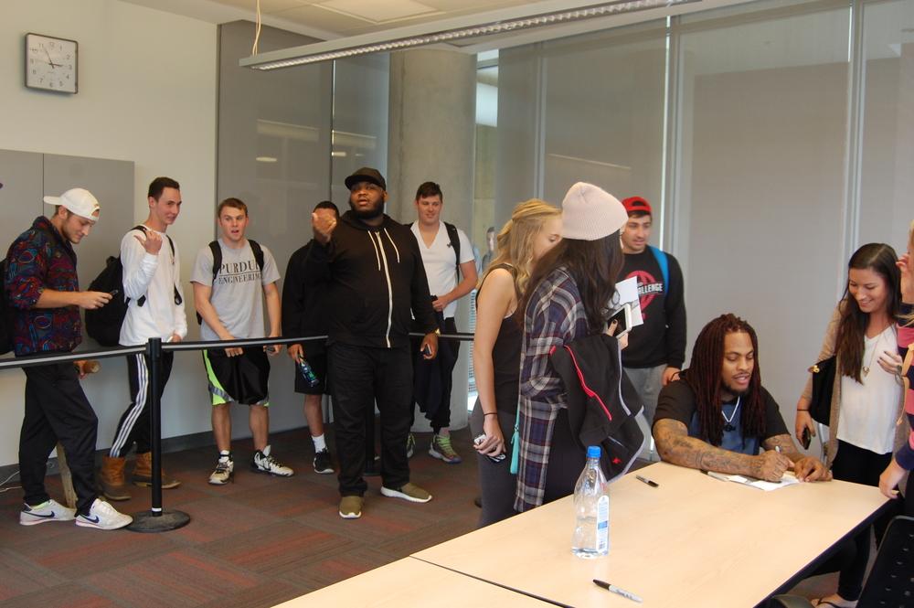 Waka signing shirts for some OSU students.