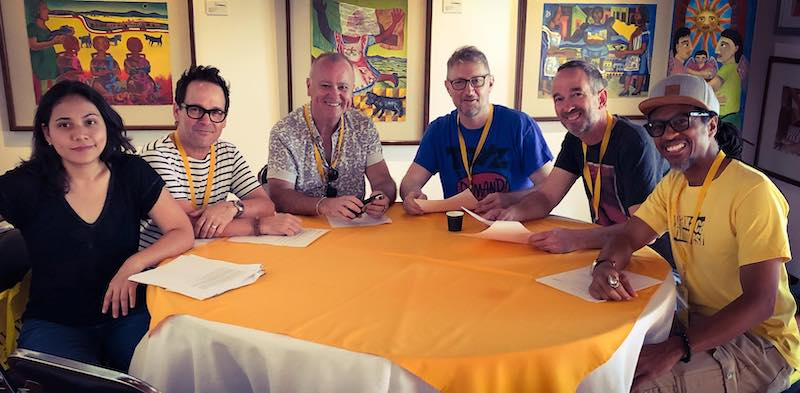 The moderators meet—and yes, the tables really are round! L-R Brenda Medina, Charles Lane, Ron Leach, Ian Keldoulis, Dave Ryan, Mateen Kemet.