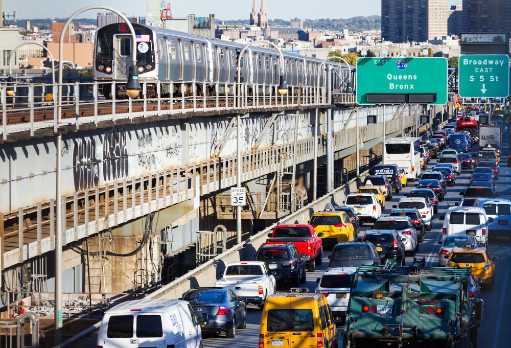Heavy traffic back ups on the Williamsburg Bridge while a subway train passes by during rush hour in New York City on October 15, 2015. Photo credit: deberarr/iStock