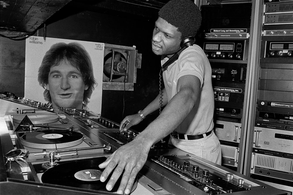 DJ Larry Levan at Paradise Garage, New York, 1979. Photography by Bill Bernstein. From the book 'Disco: The Bill Bernstein Photographs' (Reel Art Press, London 2015) discobillbernstein.com
