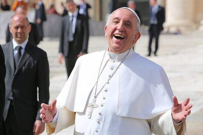 Pope Francis laughing outside of St. Peter's Basilica during the general audience the moment he heard about WINE & Shrine. Credit: Bohumil Petrik/CNA