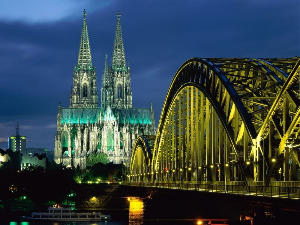 Cologne Cathedral (Kölner Dom).  The railroad bridge is leading into the underground station next to the cathedral.