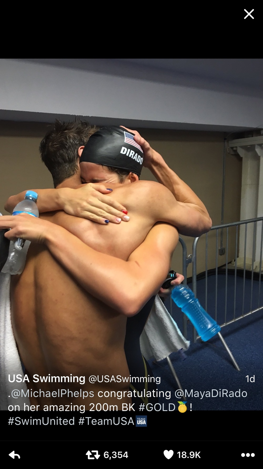Michael Phelps congratulating Maya DiRado on her win! Ms. DiRado's nails reveal a neat nail trend brought to us by the 2016 Olympic Games. Photo courtesy of USA Swimming's Twitter Feed.