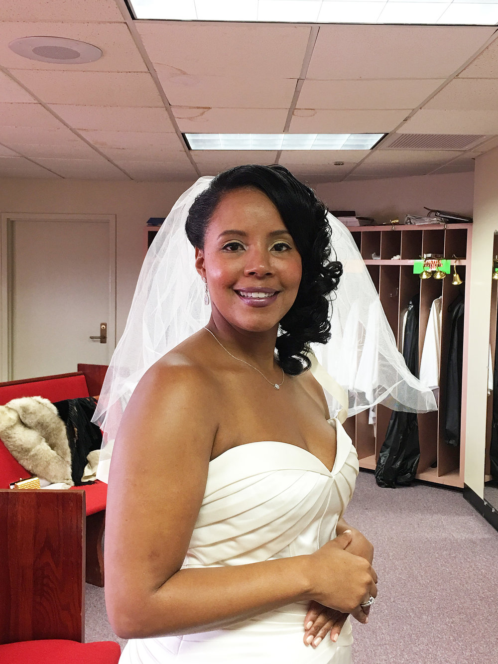Bridal client right before her walk down the aisle