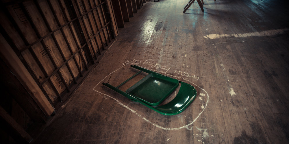 A single green folding chair. Photo by: Robbie Sweeny