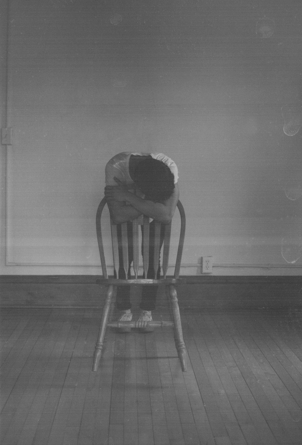 clothed leaning on chair.jpg