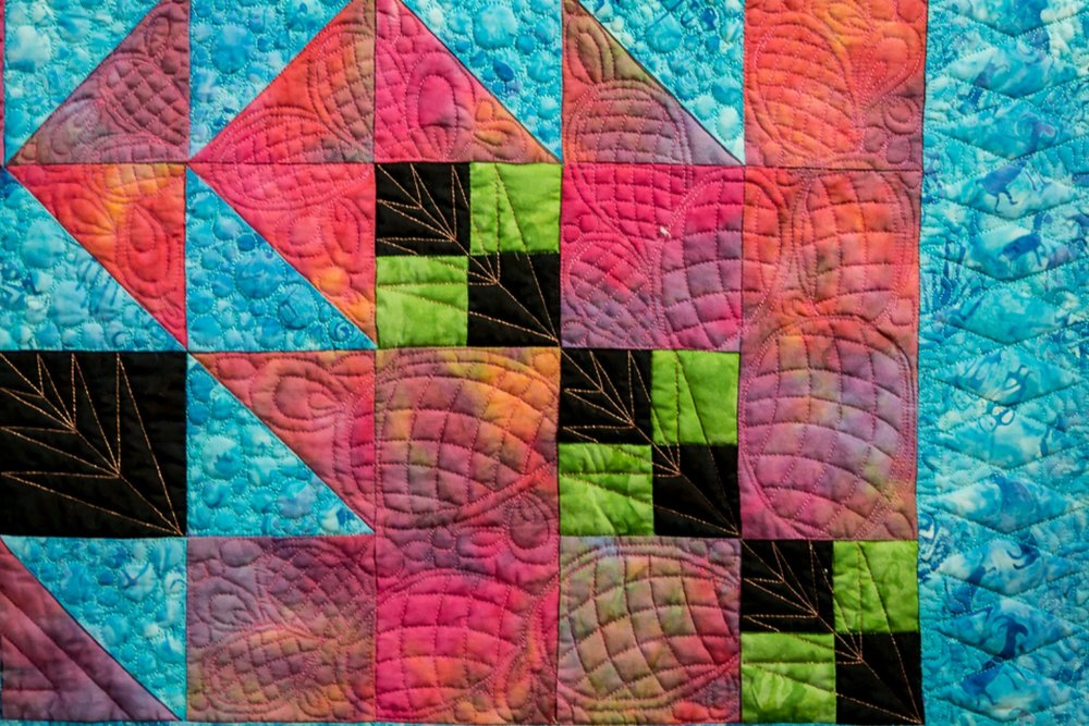 Detail of the prickly pear cactus motif stitched into all four corners.