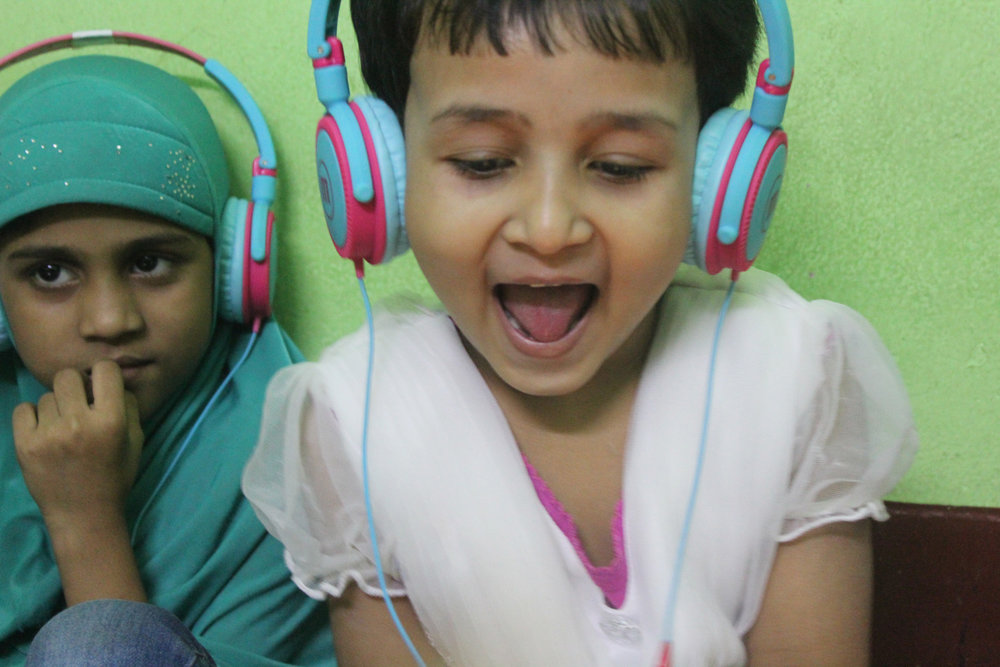 New headphones help the children to concentrate on their own work.