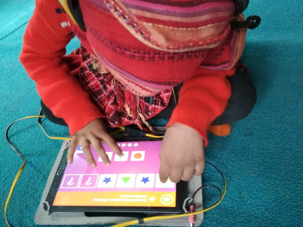 On Day 67 of the pilot project, 4-year-old Sona Maryam is completely absorbed in learning about shapes. She is using an app developed by Footsteps2Brilliance.