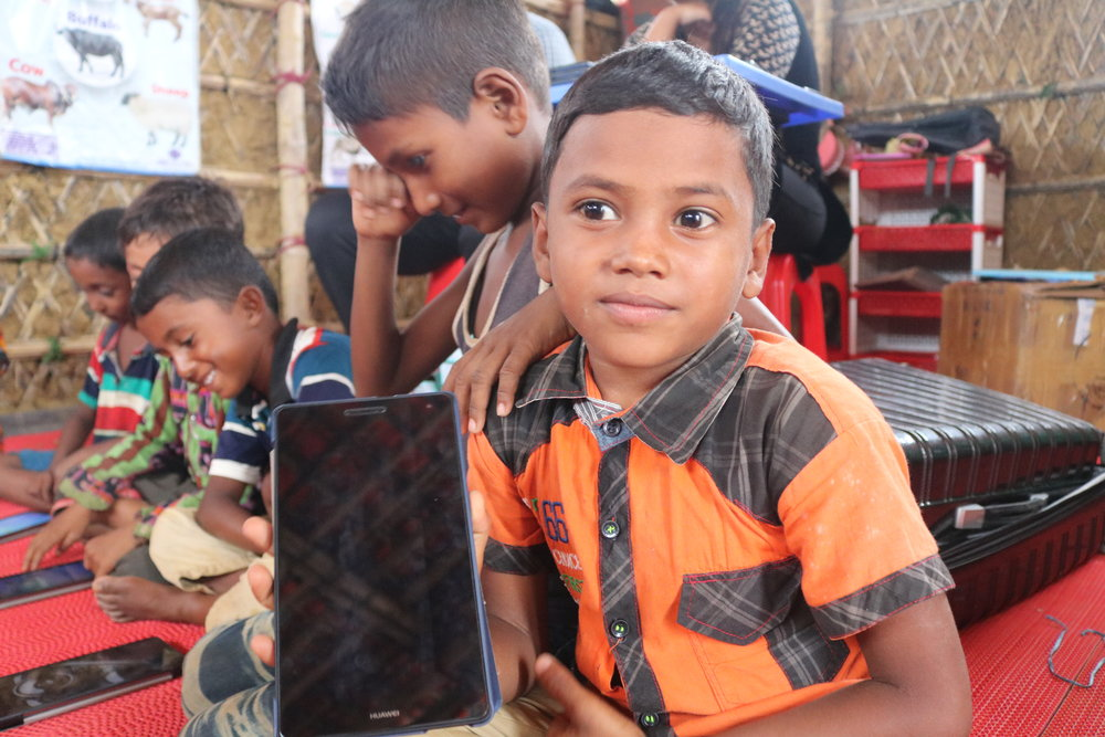 Children from the Kutupalong camp engaging with their tablets