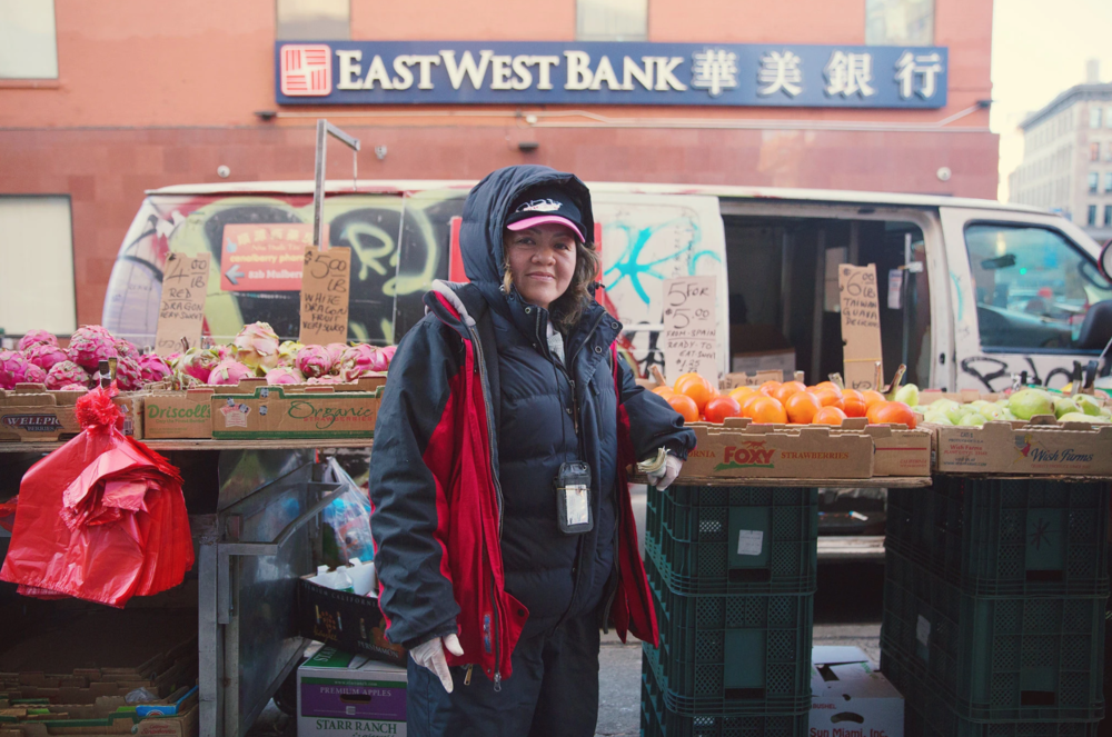 Muoi Truong at her sidewalk stand on Mulberry Street near Canal
