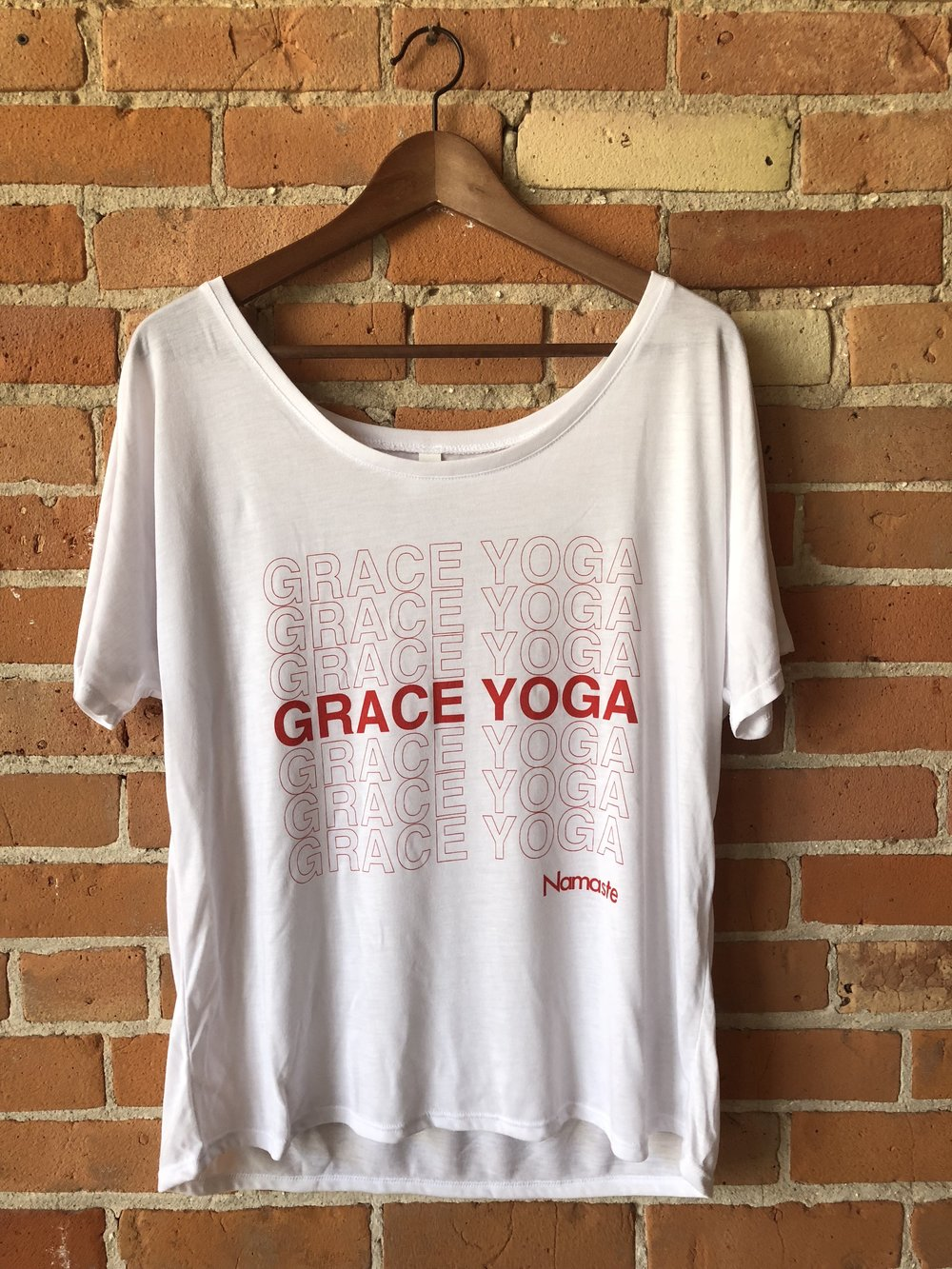 - Grace Yoga Plastic Bag Boat- Neck T-Shirt$18