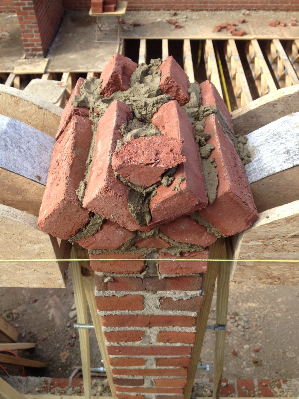 structural masonry, building out column to allow arches to spring from