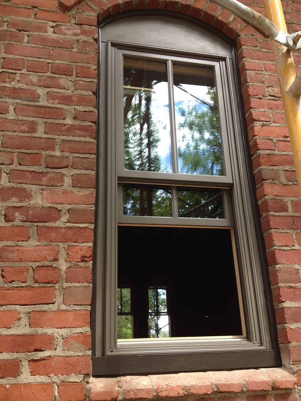 """structural masonry, window system pocketed 4"""" inside a triple wythe wall"""