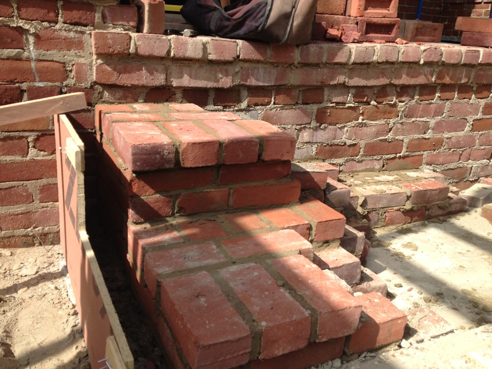 structural masonry, showing the coursework of a solid brick staircase.
