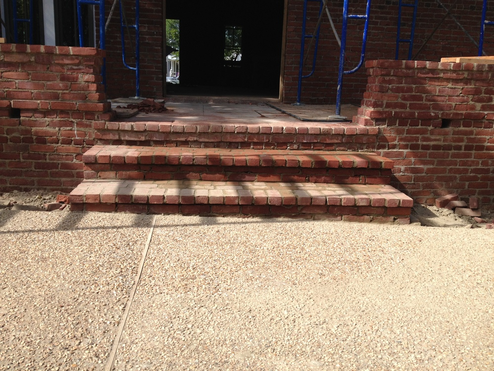 structural masonry, front porch steps built out of solid brick and mortar