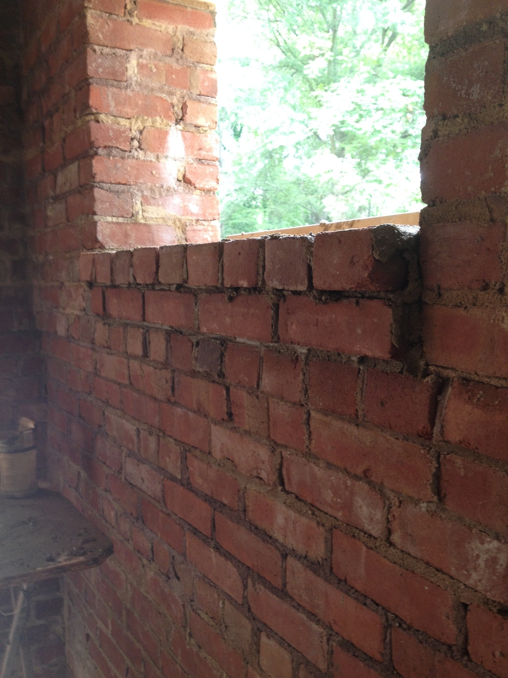 structural masonry, corbeled window ledge detail