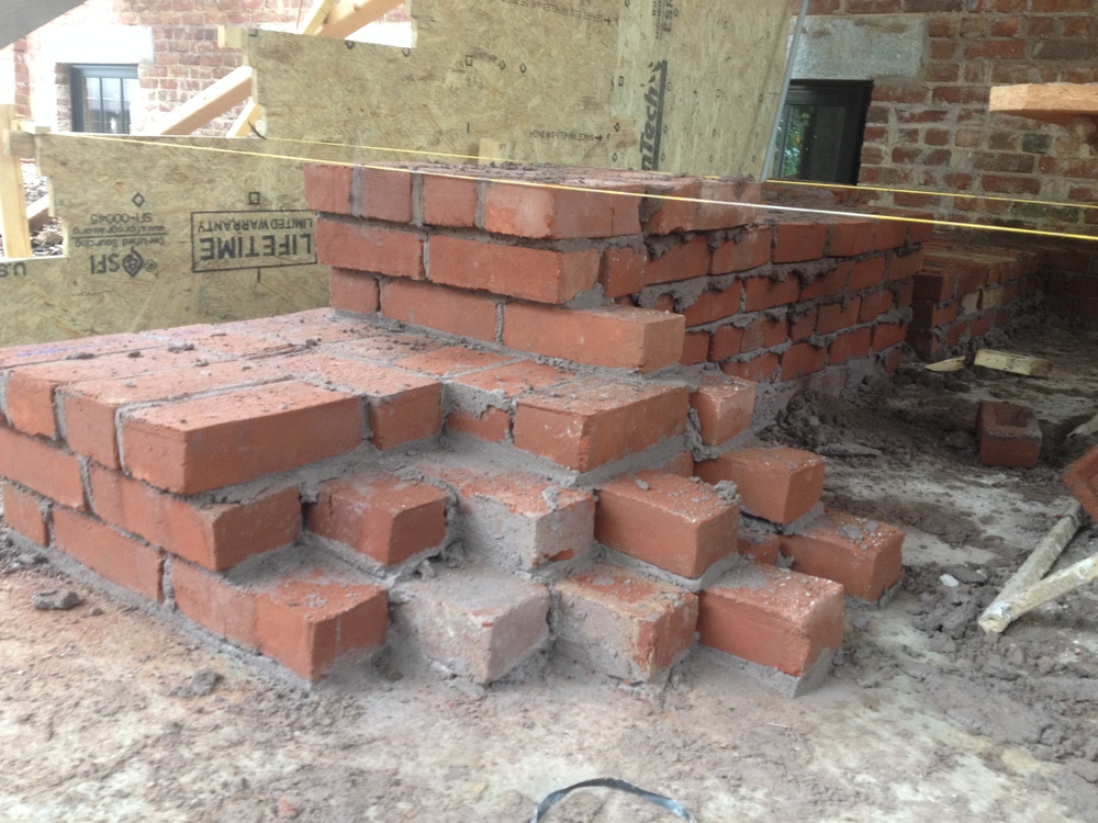 structural masonry, front steps' solid brick coursework