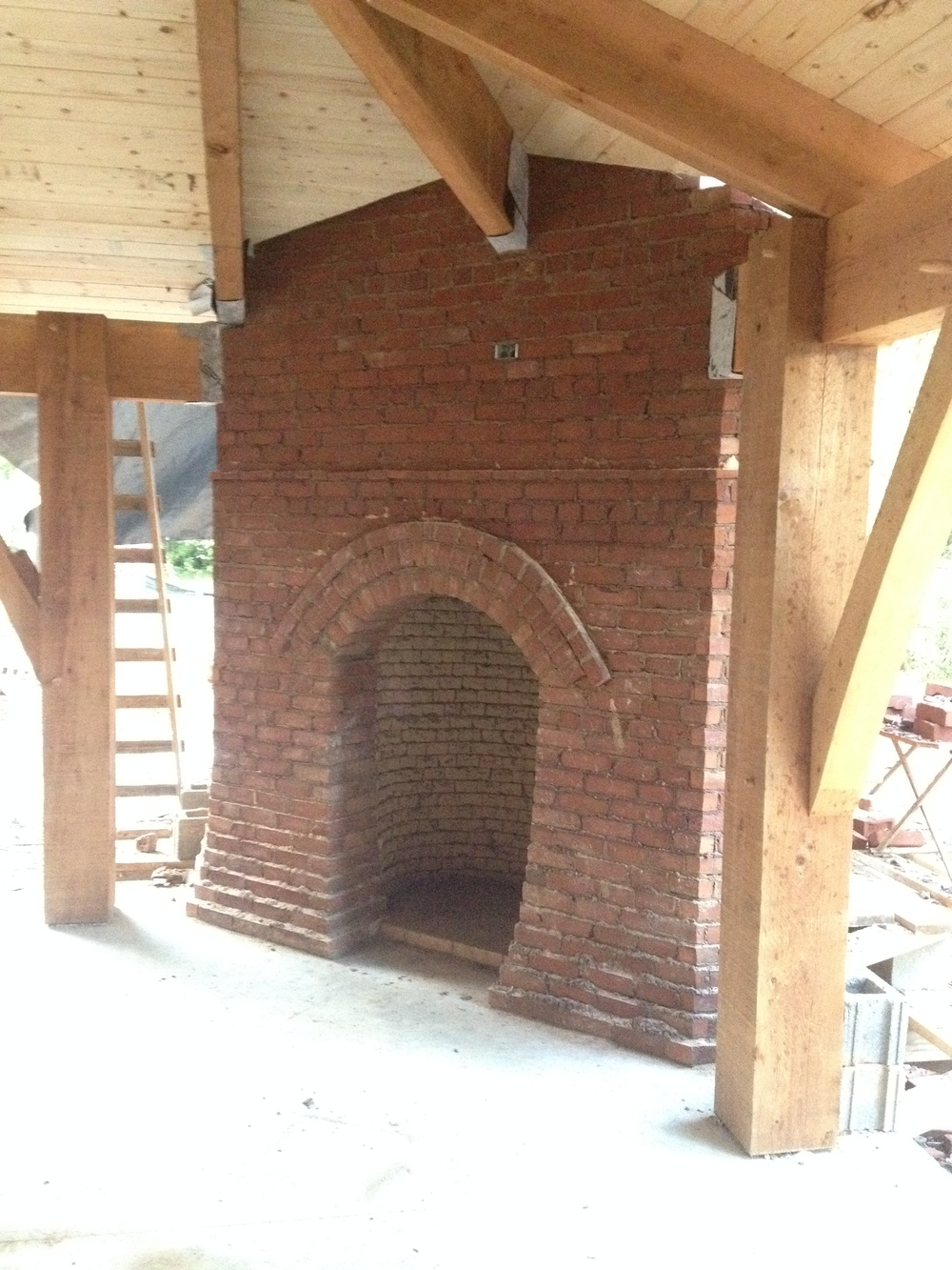structural masonry, finished outside, porch fireplace with timber framing elements