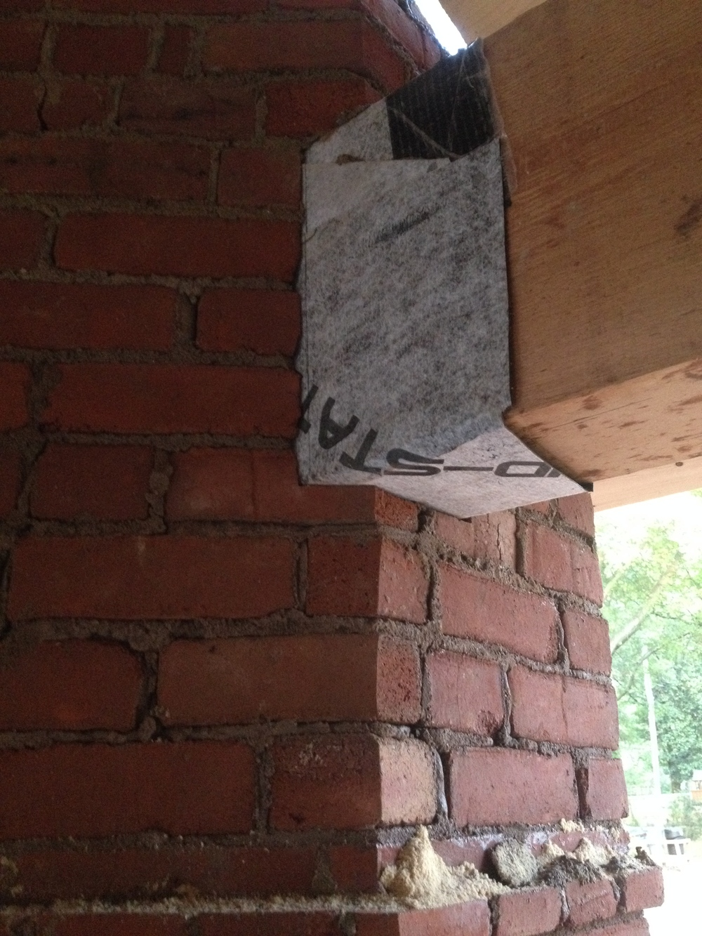 structural masonry, bricking around timber framed beam meeting the fireplace