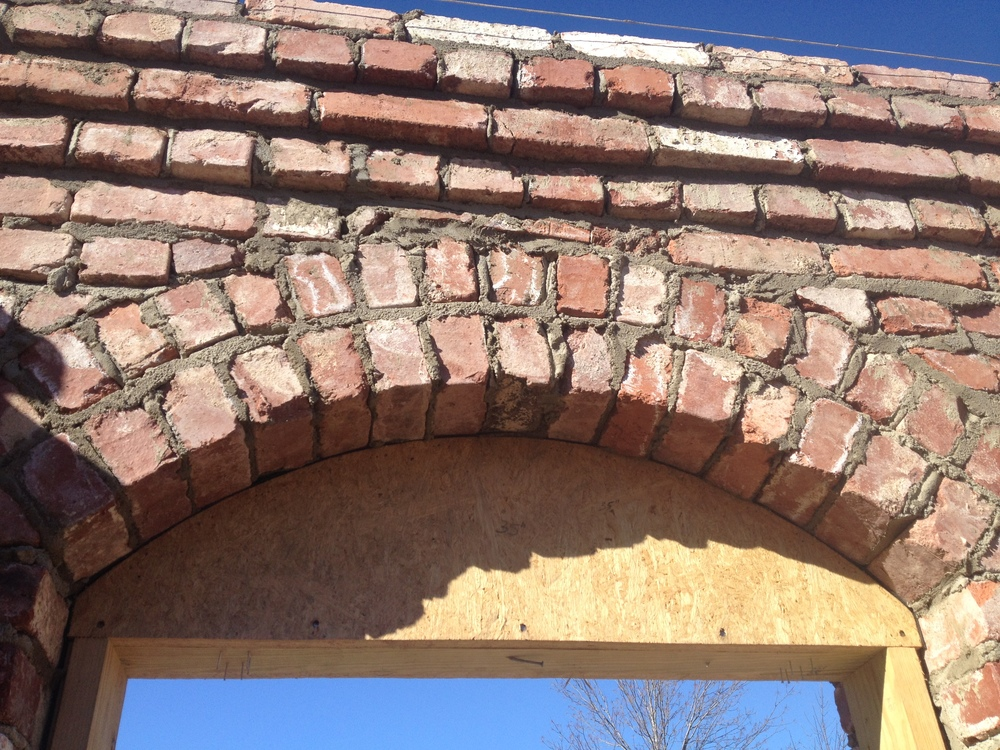 structural masonry, detail of arch and corbeled ledger for second story floor system