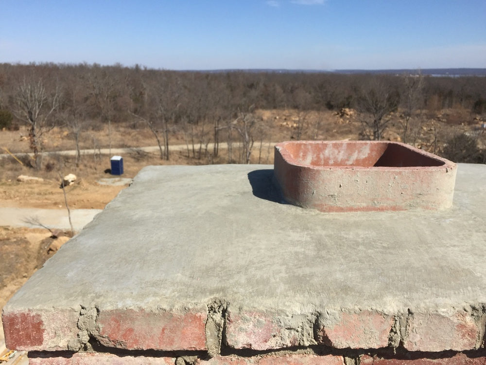 structural masonry, proper cement capping applied to the top of a solid brick chimney