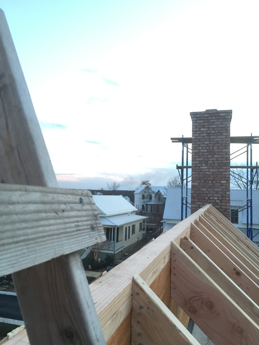 structural masonry, ridge-line perspective of solid brick chimney