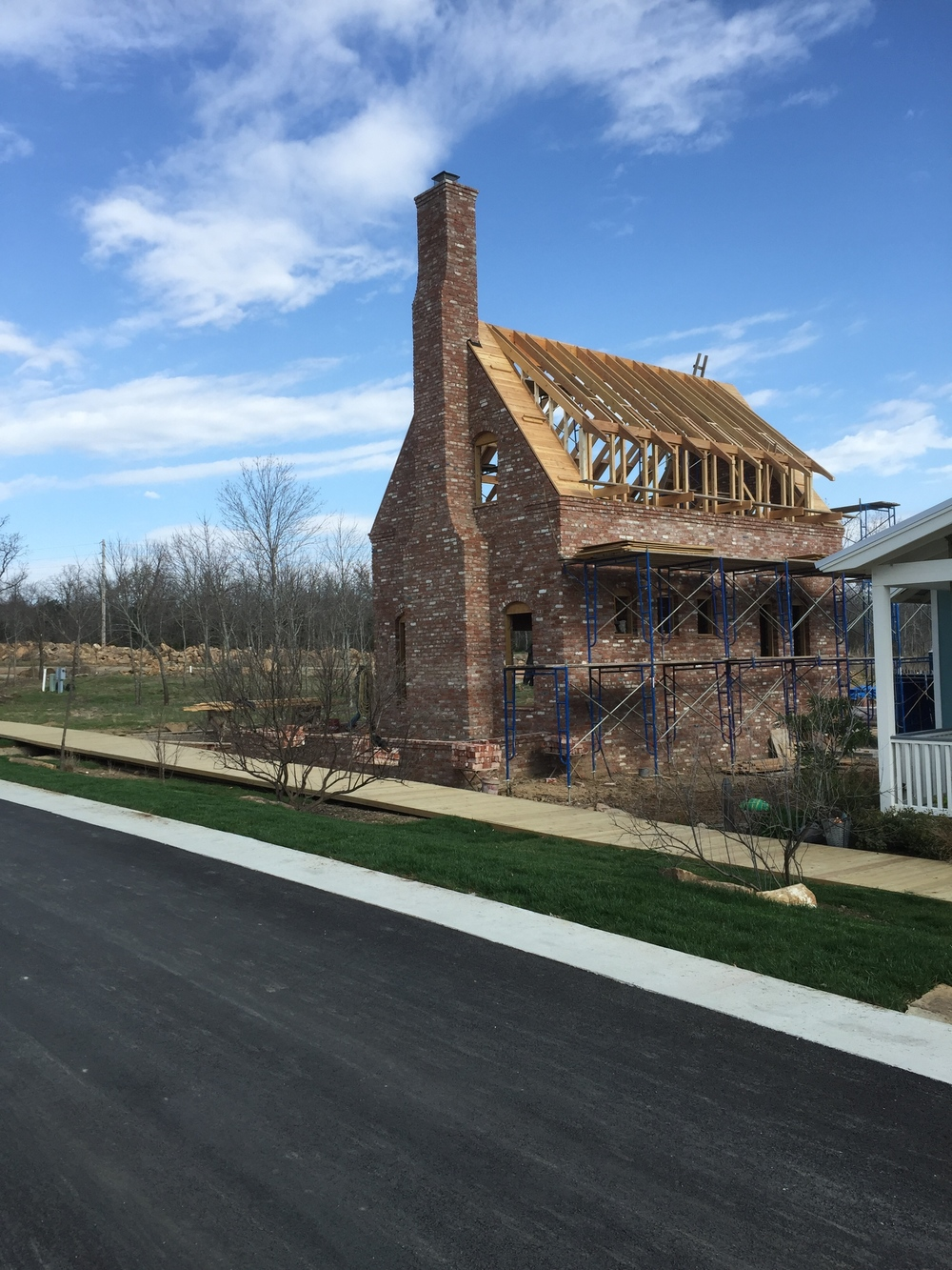 structural masonry, street view of solid brick fireplace with a reverse corbeled chimney