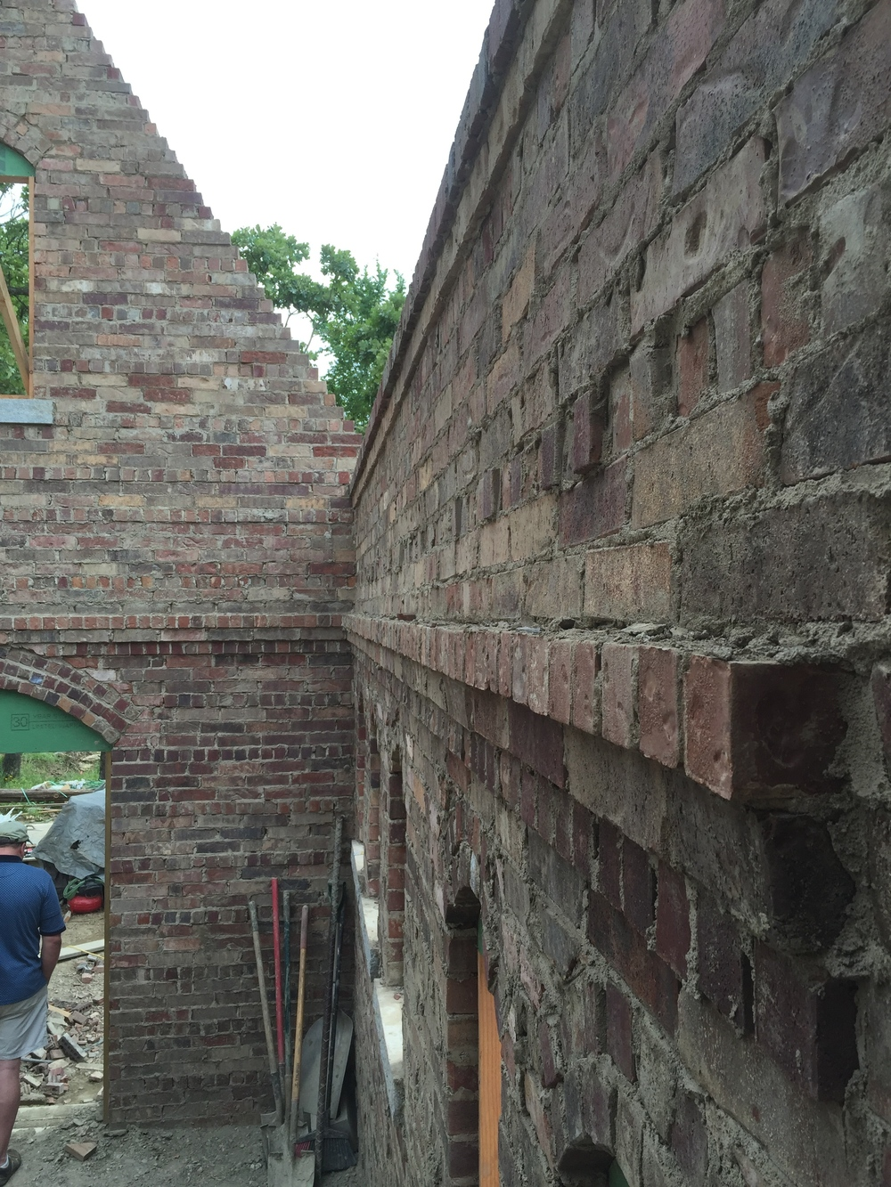 structural masonry, corbeled ledge for floor system in a small brick cottage