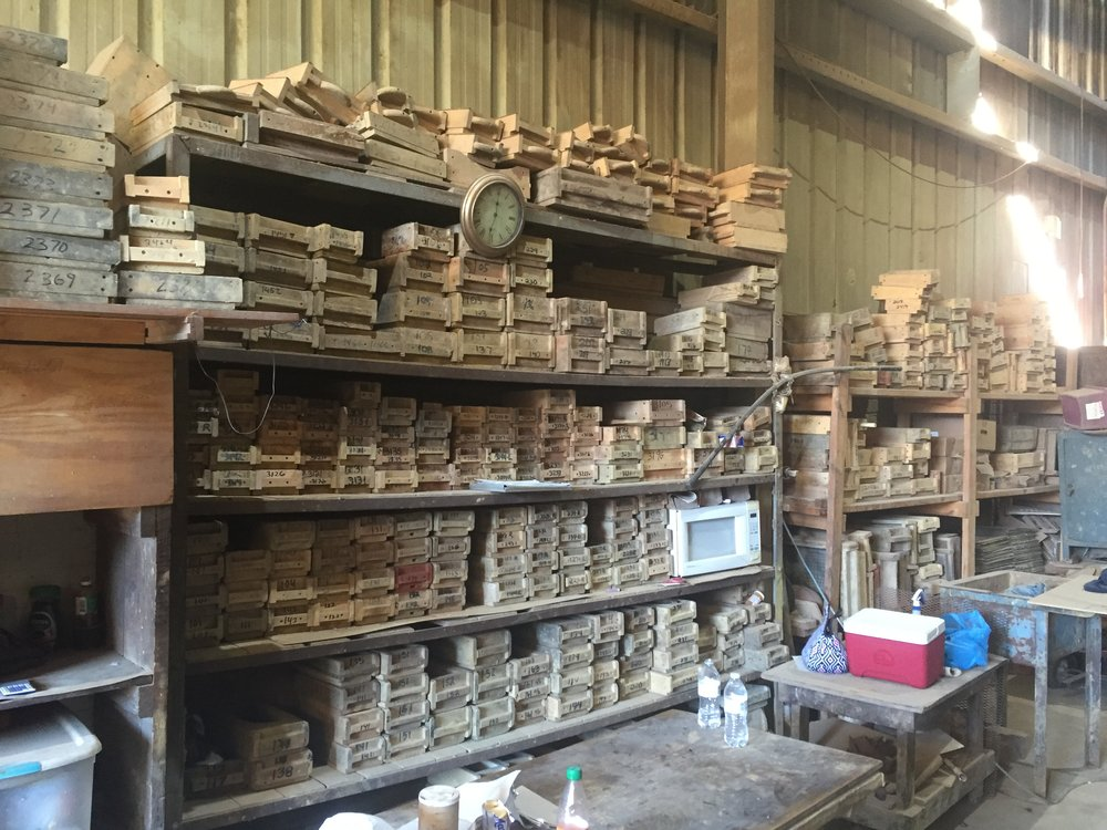 A wall of custom molds and forms