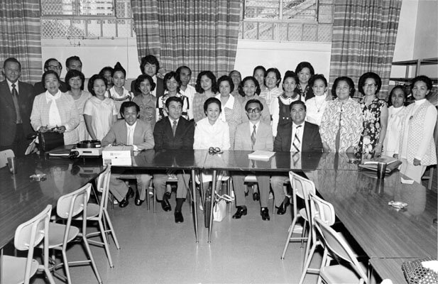 Group of people posing for a picture at the Filipino Education Center (1974)