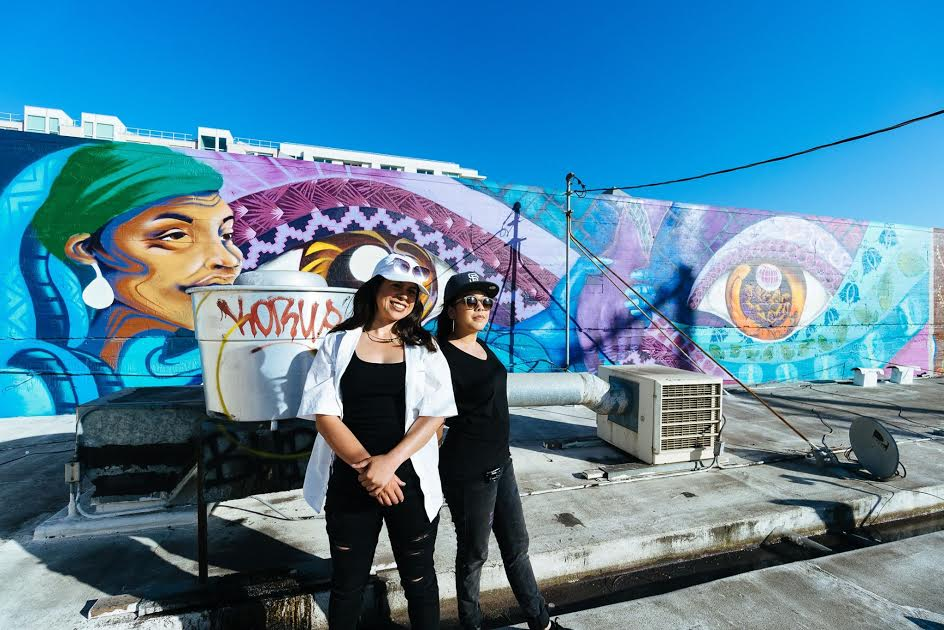 Artists of the mural at 595 Bryant -- Samantha Schilf and  Monica Magtoto