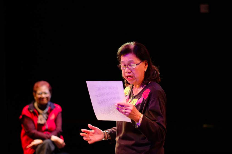 Elizabeth Aquino reading a monologue with emotion. Zenaida Bumagan watching in the background.