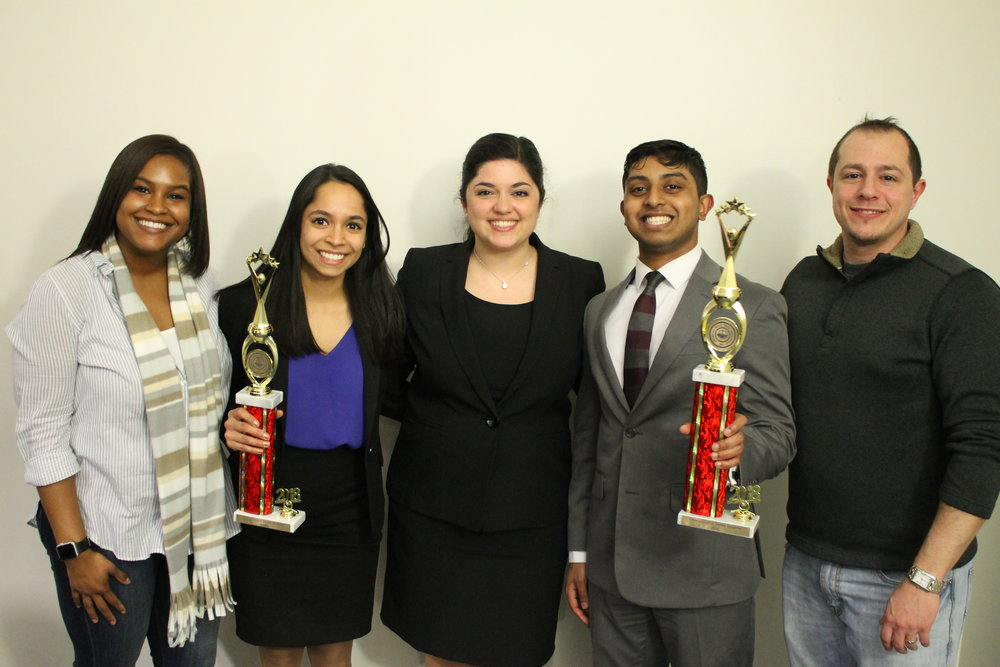Left to right: Zaniah Maynor (  Assistant Coach), Anu Chugh (B-Team Captain), Nicoletta Eby (President), Michael Nanchanatt (A-Team Captain), Michael Roberts (Head Coach).