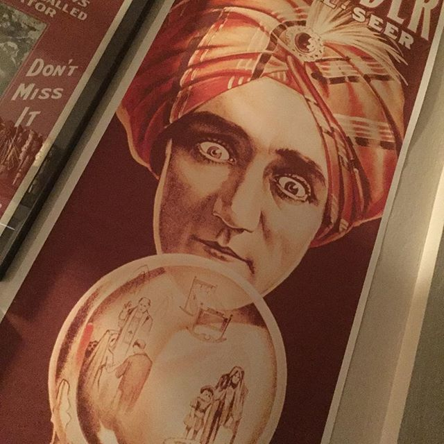 The most intimidating poster in the joint.  Seriously, it stairs down at you from high on the wall and I swear I've seen those eyes move. @calmagictheatre #magiccollection #alexander #themanwhoknows
