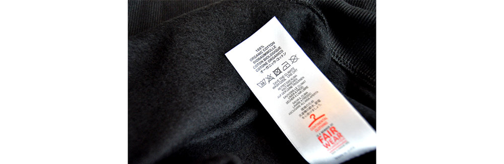 Label from our black organic cotton sweatshirt