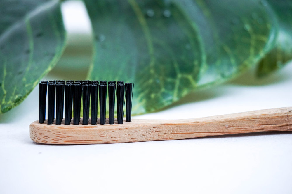 eco-friendly-bamboo-toothbrushes-ethical-clothing-uncaptive-plastic-free.jpg
