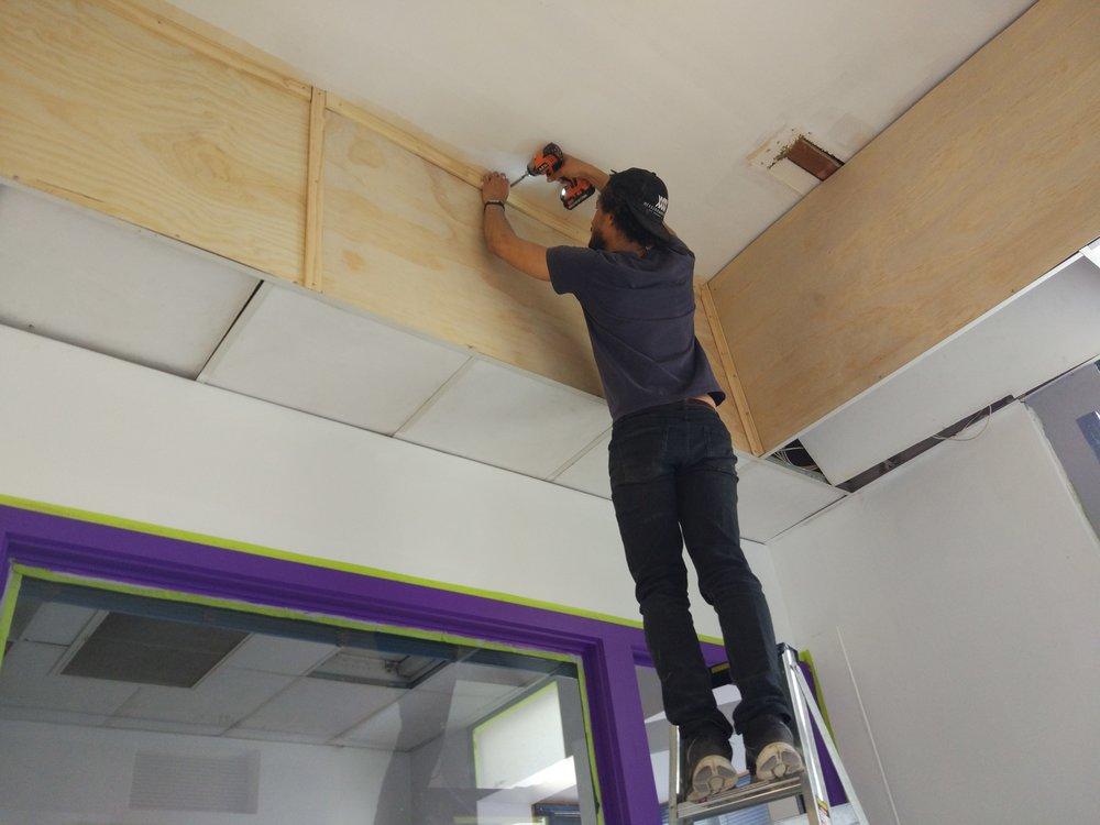 Dans installing the atrium