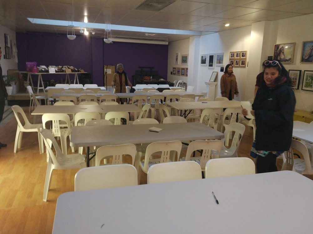 The Adelaide Uni Art History Club deep in concentration as they work out their quiz night arrangements